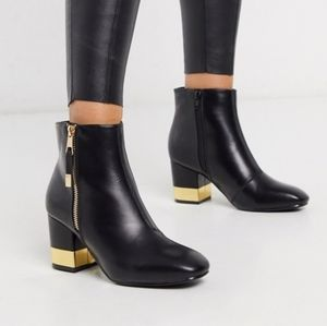 Black boots with gold trim